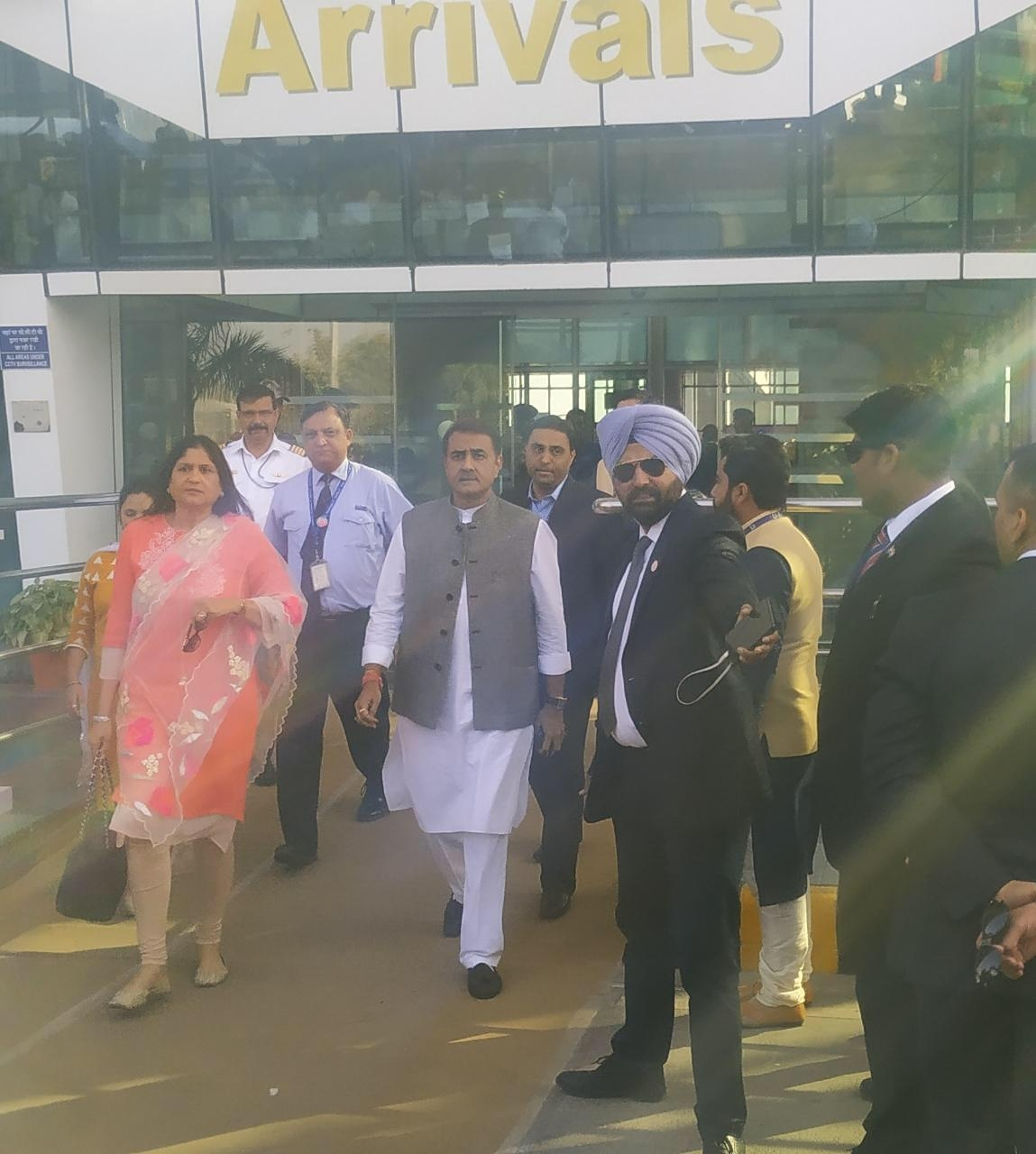 Former union minister Praful Patel arrives at the Udaipur Airport with his wife.