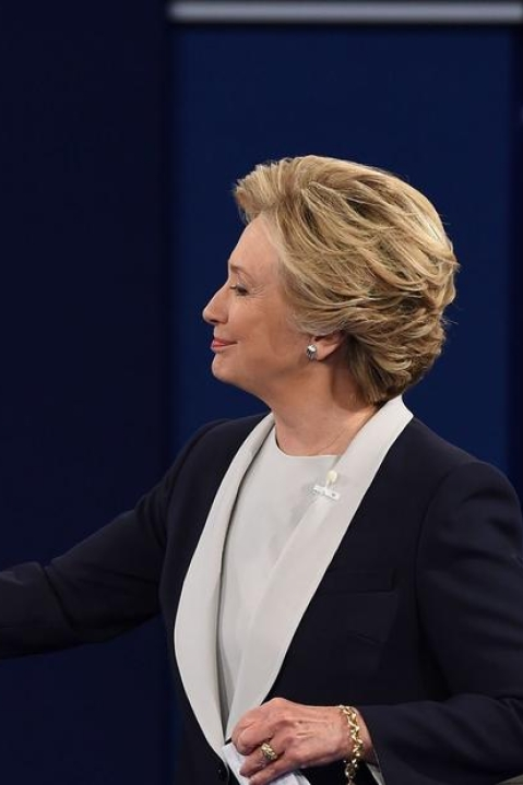 Democratic presidential candidate Hillary Clinton and US Republican presidential candidate Donald Trump shakes hands after the second presidential debate at Washington University in St. Louis, Missouri, on October 9, 2016.