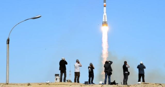 Russia's Soyuz MS-10 spacecraft, carrying Russian cosmonaut Alexey Ovchinin and Nasa astronaut Nick Hague, blasts off at the Russian-leased Baikonur cosmodrome in Baikonur.