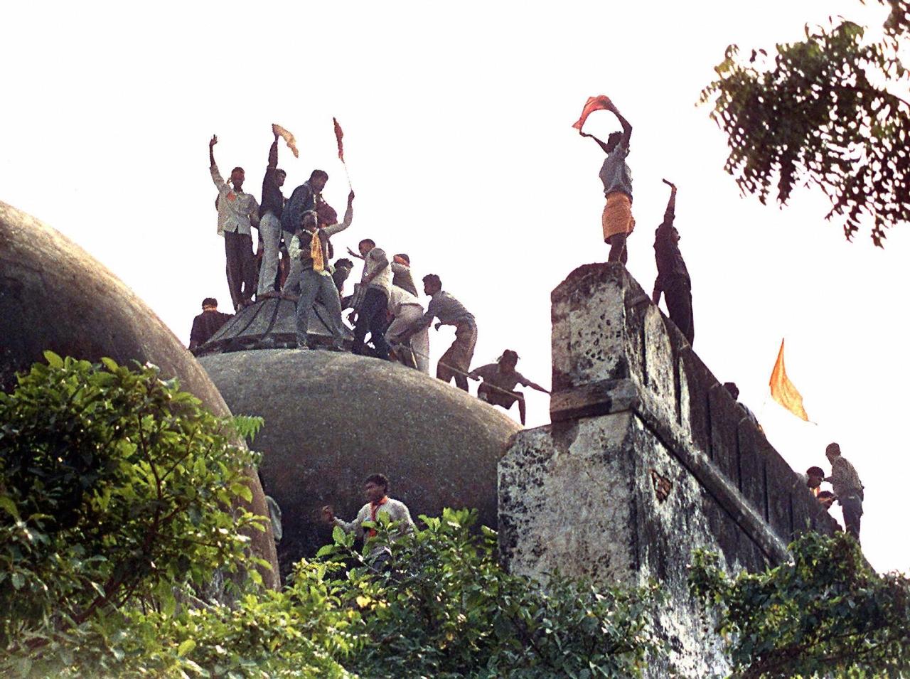 Hindu youth demolishing Babri Masjid.