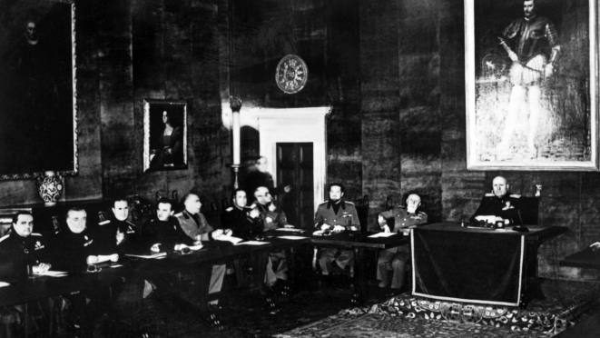 Picture taken on 15 April 1939 of Benito Mussolini (R) and members of the Grand Council of Fascism during a meeting. Italian dictator Benito Mussolini and his National Fascist Party came to power through a coup d'état on 28 October 1922. AFP/Getty Images