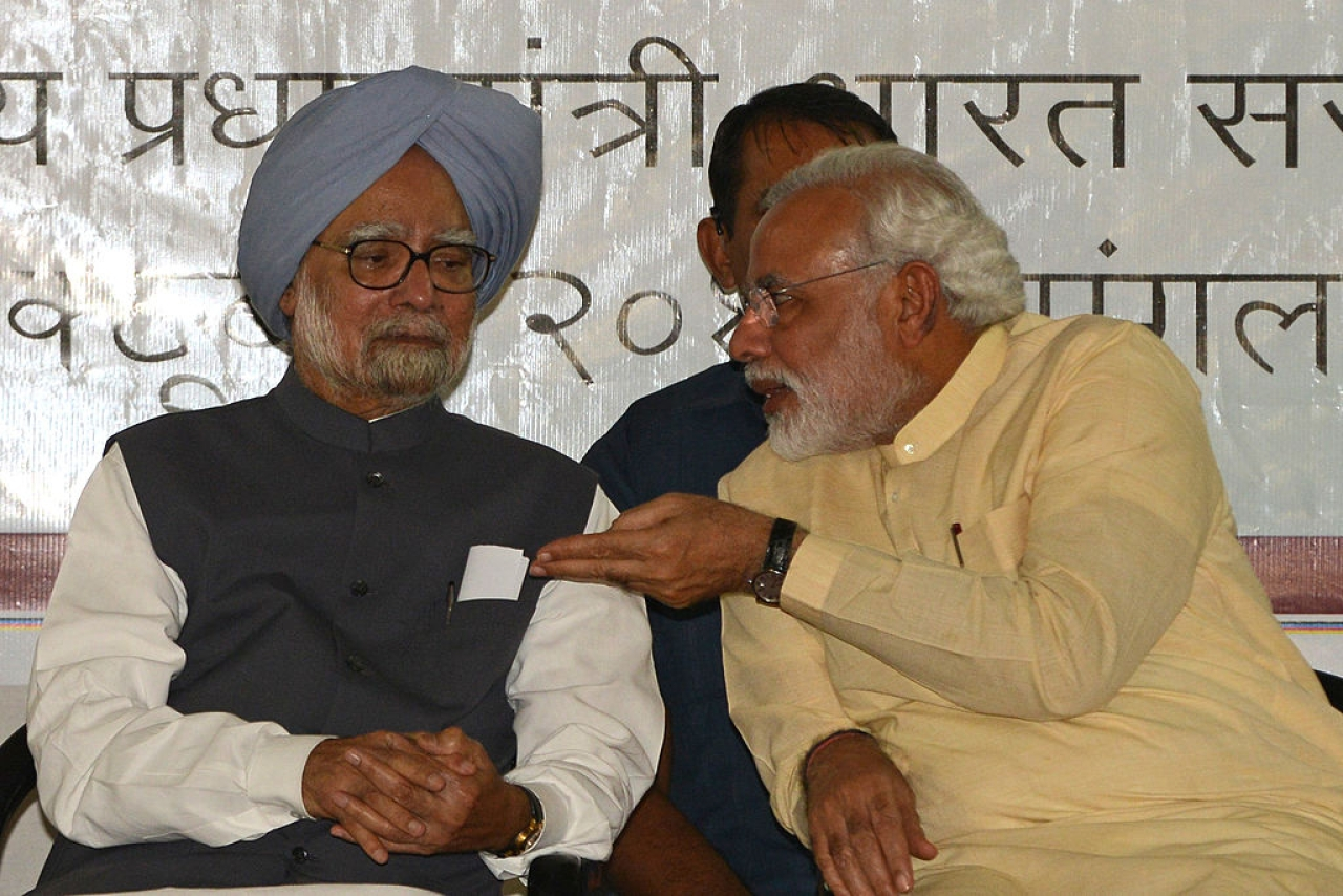Manmohan Singh and Narendra Modi (SAM PANTHAKY/AFP/Getty Images)