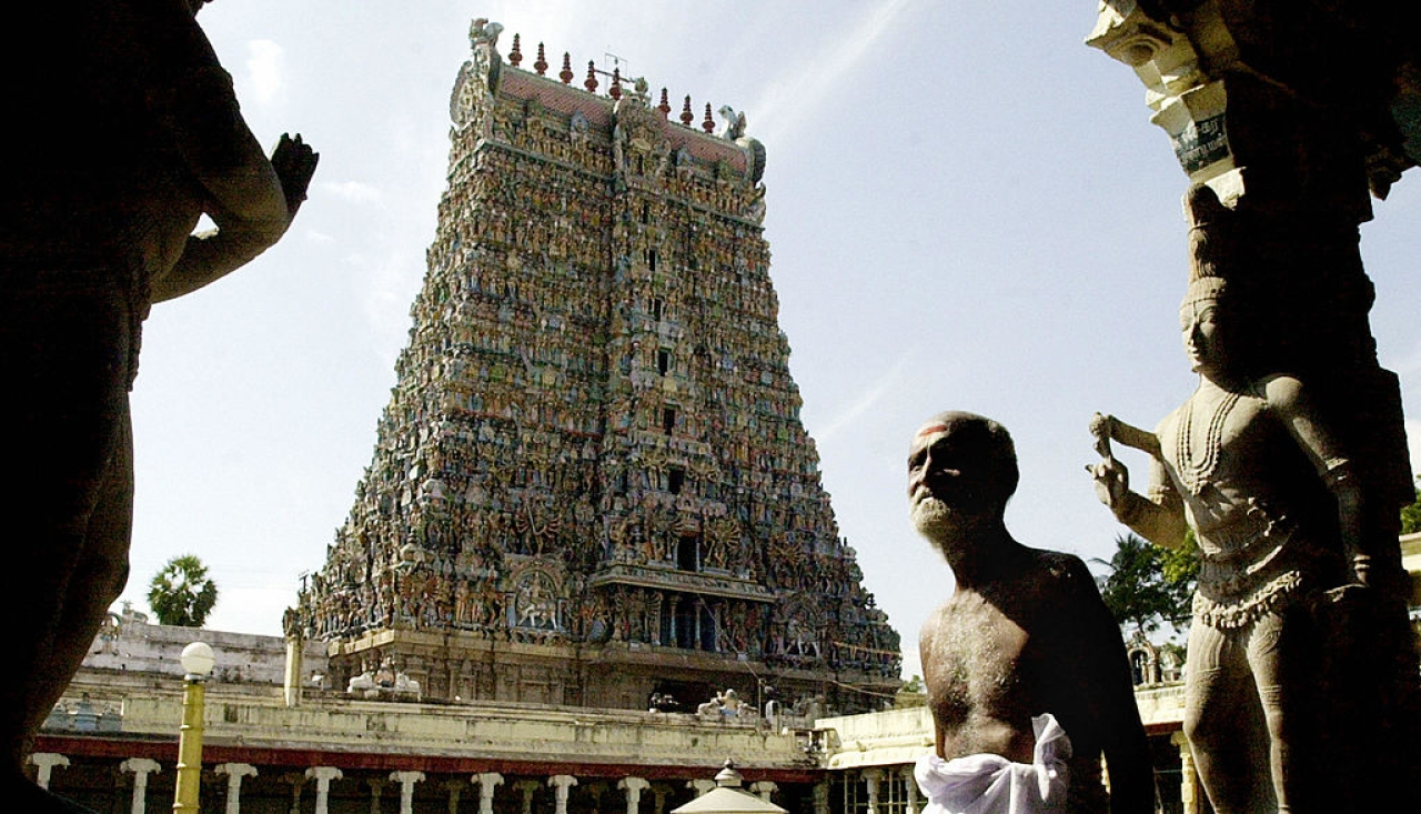 A devotee walks past the entrance to the Meenakshi temple in Madurai (DIBYANGSHU SARKAR/AFP/GettyImages)
