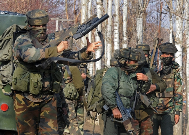 Indian Army soldiers stand near the scene of a gun battle. (TAUSEEF MUSTAFA/AFP/Getty Images)