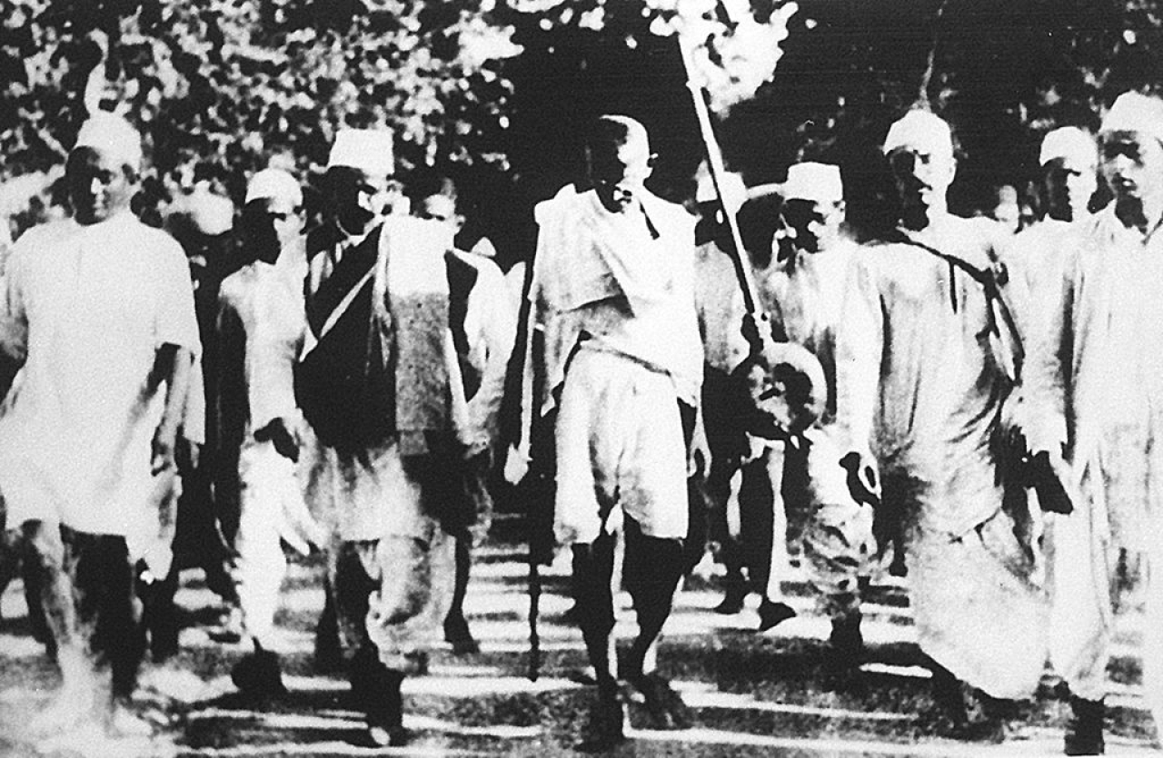 Mohandas Karamchand Gandhi (C) is pictured with his followers on the famous salt march to Dandi (AFP/Getty Images)