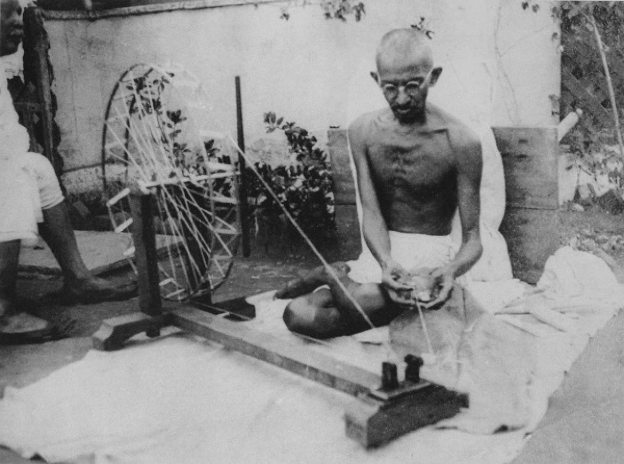 Mahatma Gandhi spinning yarn, in the late 1920s (Wikimedia Commons)