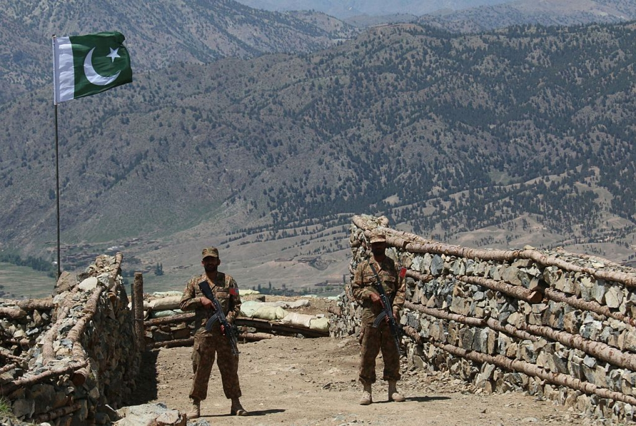 Pakistani soldiers keep vigil from a post on top of a mountain. (STR/AFP/Getty Images)