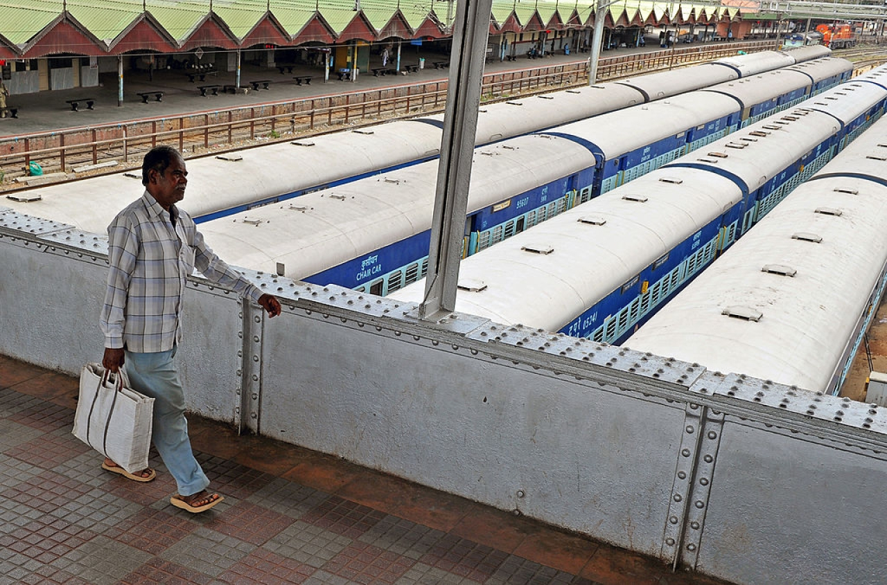 A commuter uses an overhead bridge to get across platforms at the City Railway Station in Bengaluru. (Manjunath Kiran/AFP/Getty Images)
