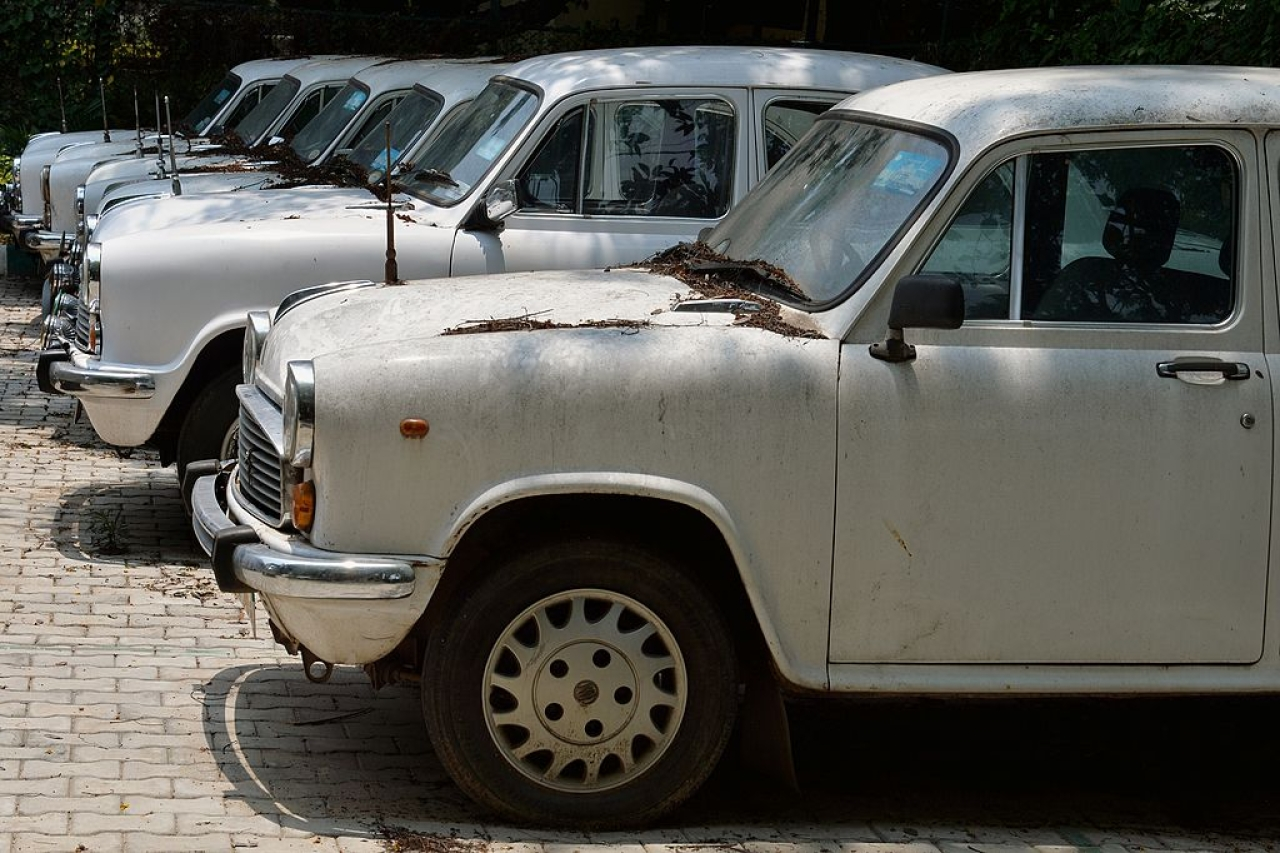 Defunct Ambassador cars of the state government gather dust at a parking lot in Bengaluru.(MANJUNATH KIRAN/AFP/GettyImages)