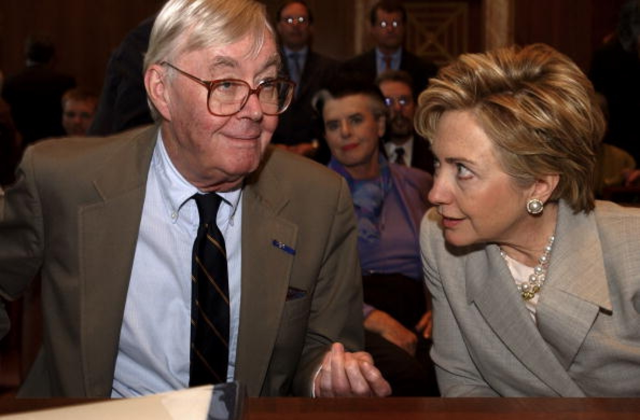 Daniel Patrick Moynihan talks with Hillary Clinton before the start of the nomination  of Theresa Alvillar-Speake. (Douglas Graham/Roll  Call/Getty Images)