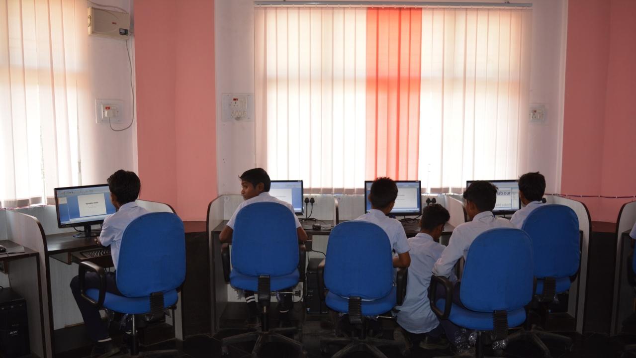 Students at the computer lab at Aastha Vidya Mandir, Dantewada