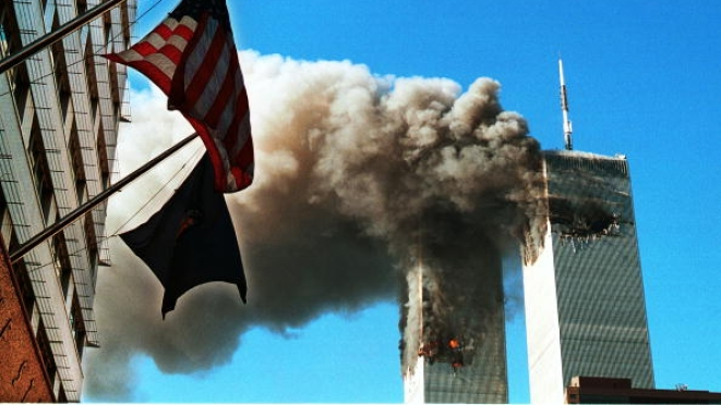Smoke pouring from the World Trade Center after it was hit by two planes on 11 September 2001 in New York City. (Craig Allen/Getty Images)