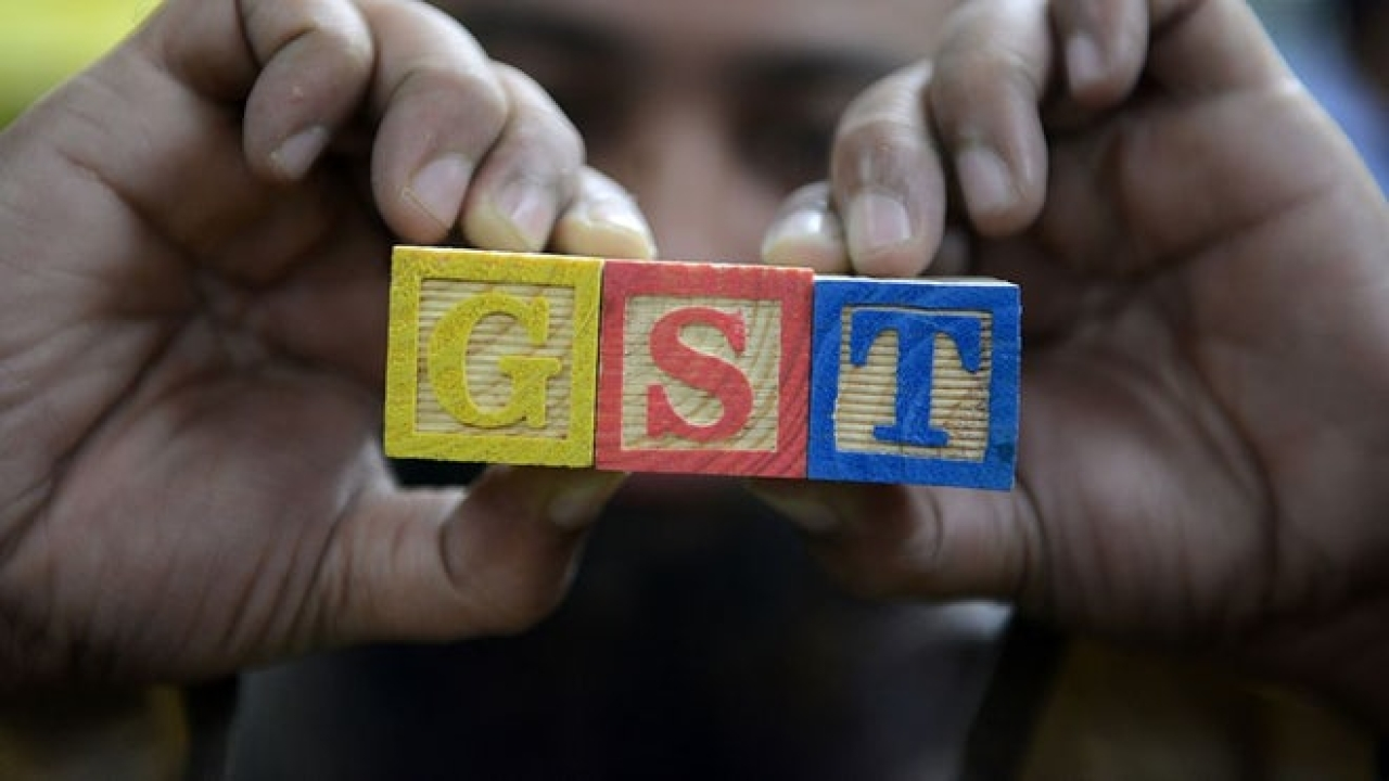 GST, a transformative change. (NOAH SEELAM/AFP/GettyImages)