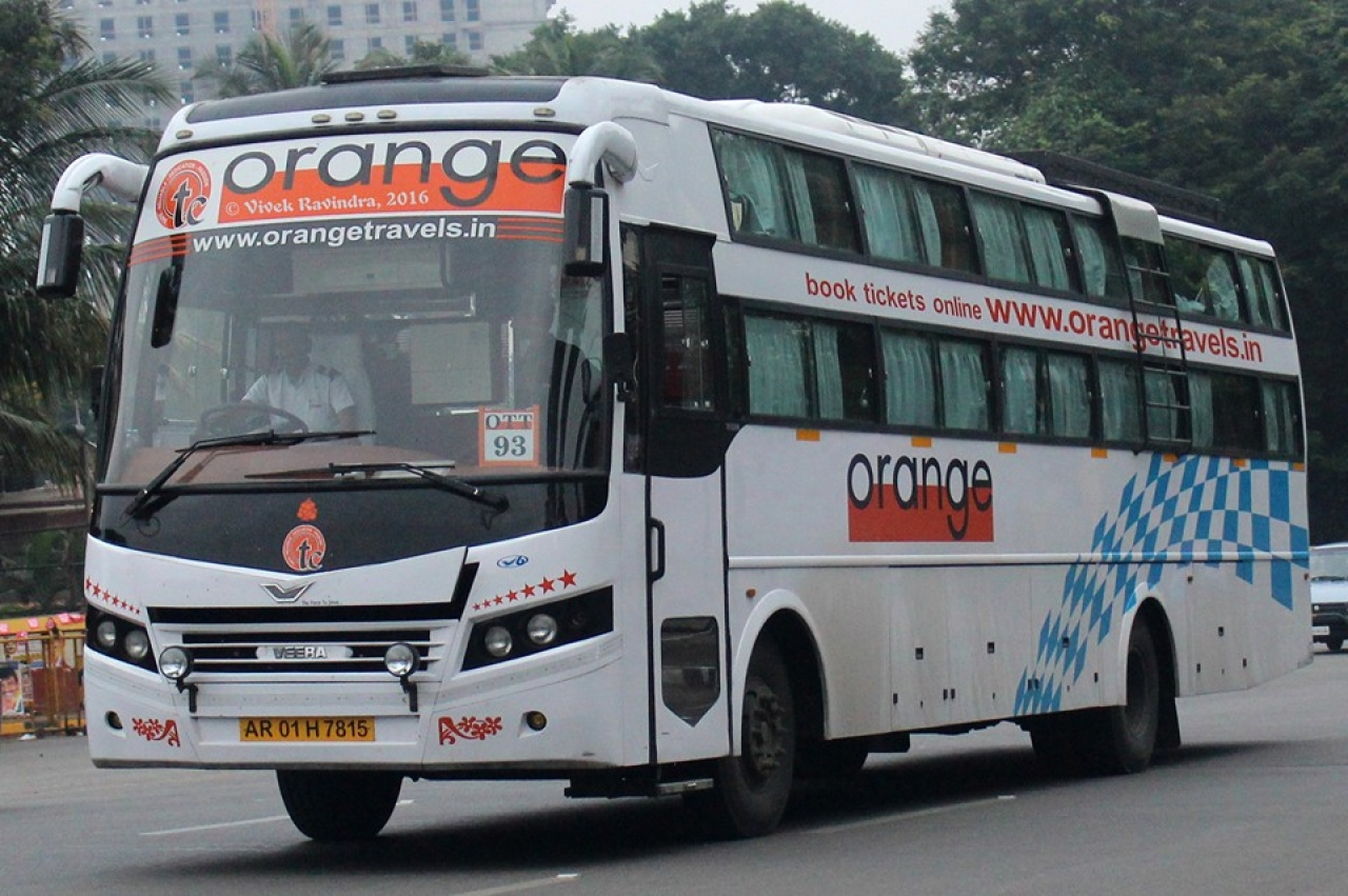 An Orange Travels Bus with an Arunachal registration (Photo Credit: Vivek Ravindra/ BCM Touring)