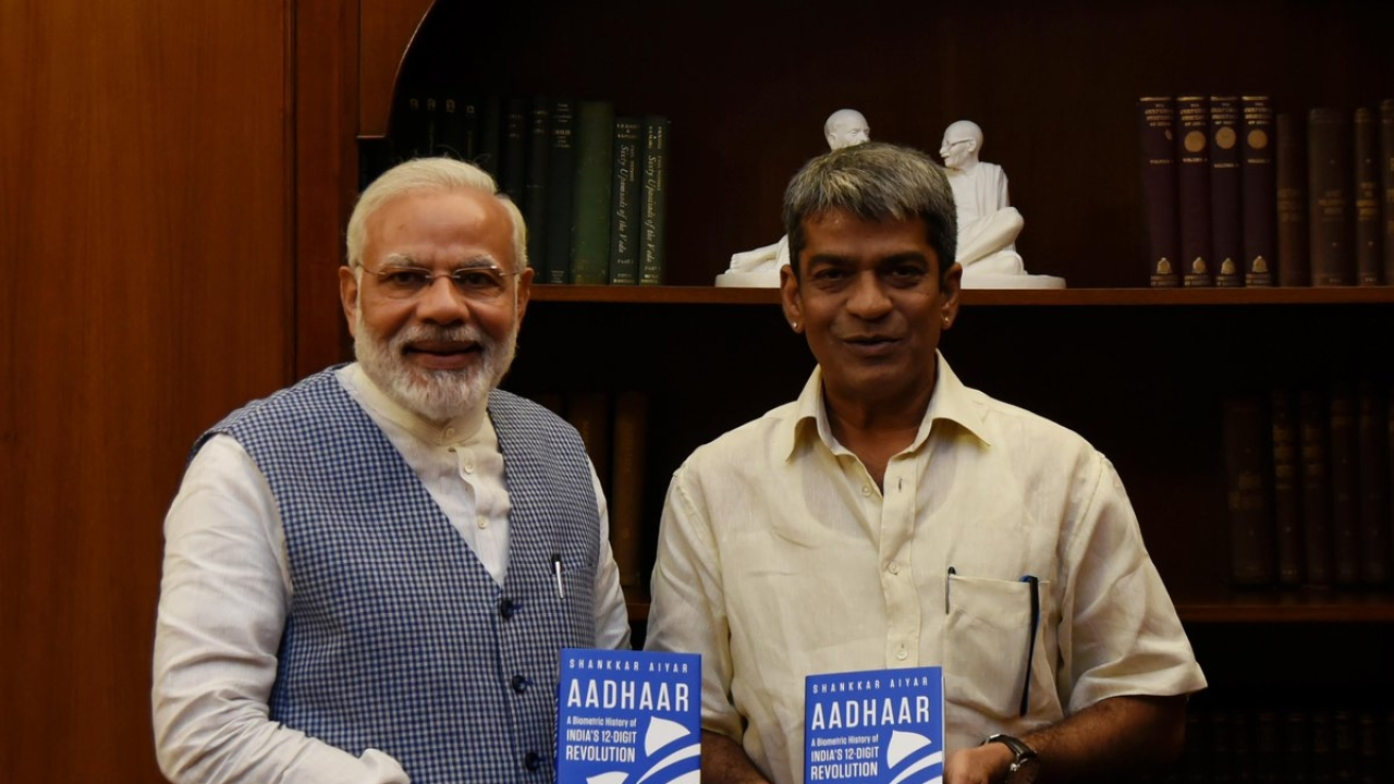 The author presents a copy of his book to Prime Minister Modi