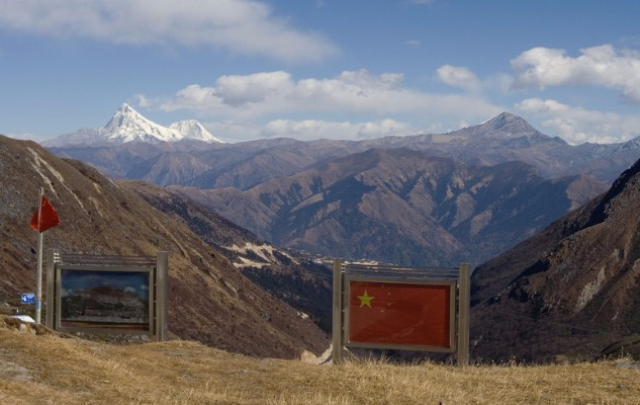 """Picture of the Patola Palace, left, and the Chinese flag, on the  Chinese side of the international border at Nathula Pass, in Sikkim.   <a href=""""https://www.flickr.com/photos/shons/"""">(Shayon Ghosh/Flickr)</a>"""