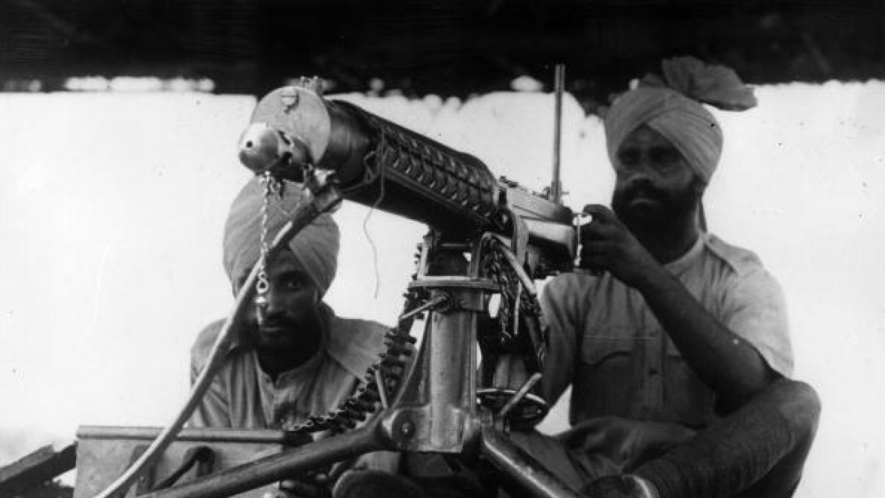 Two Indian gunners, contributing their services to the Allied Army, at their machine gun in the Libyan desert. (Keystone/Getty Images)