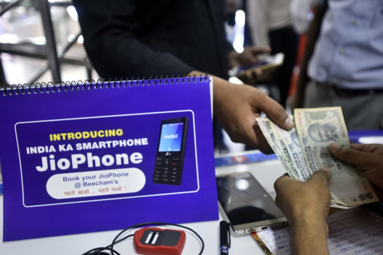 A customer at Reliance store for Jio phone pre-booking at Connaught Place in New Delhi. (Arun Sharma/Hindustan Times via GettyImages)