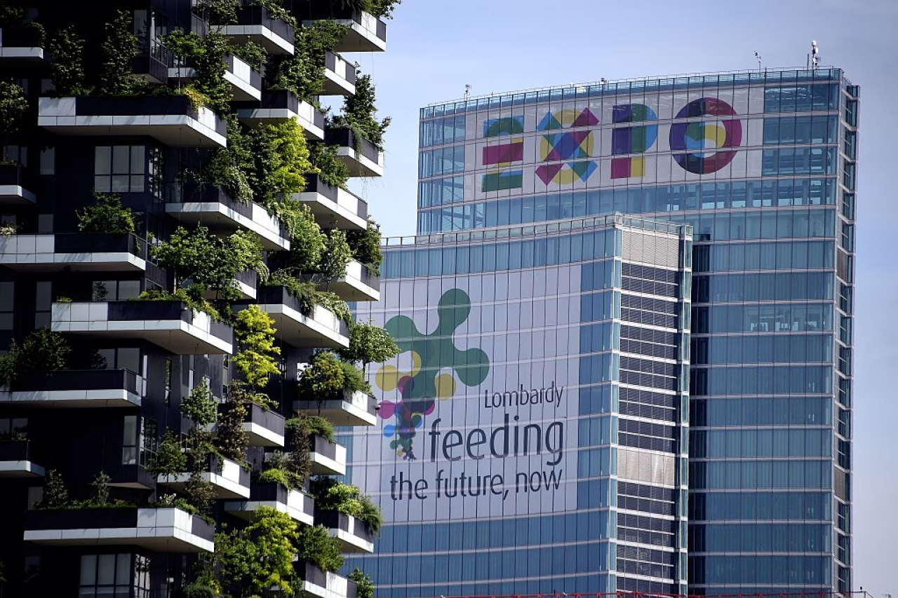 A picture shows the Lombardia Region building advertizing EXPO2015 (R) and a part of the Bosco Verticale towers (Vertical Forest) in the Porta Nuova area on April 28, 2015. (OLIVIER MORIN/AFP/Getty Images)