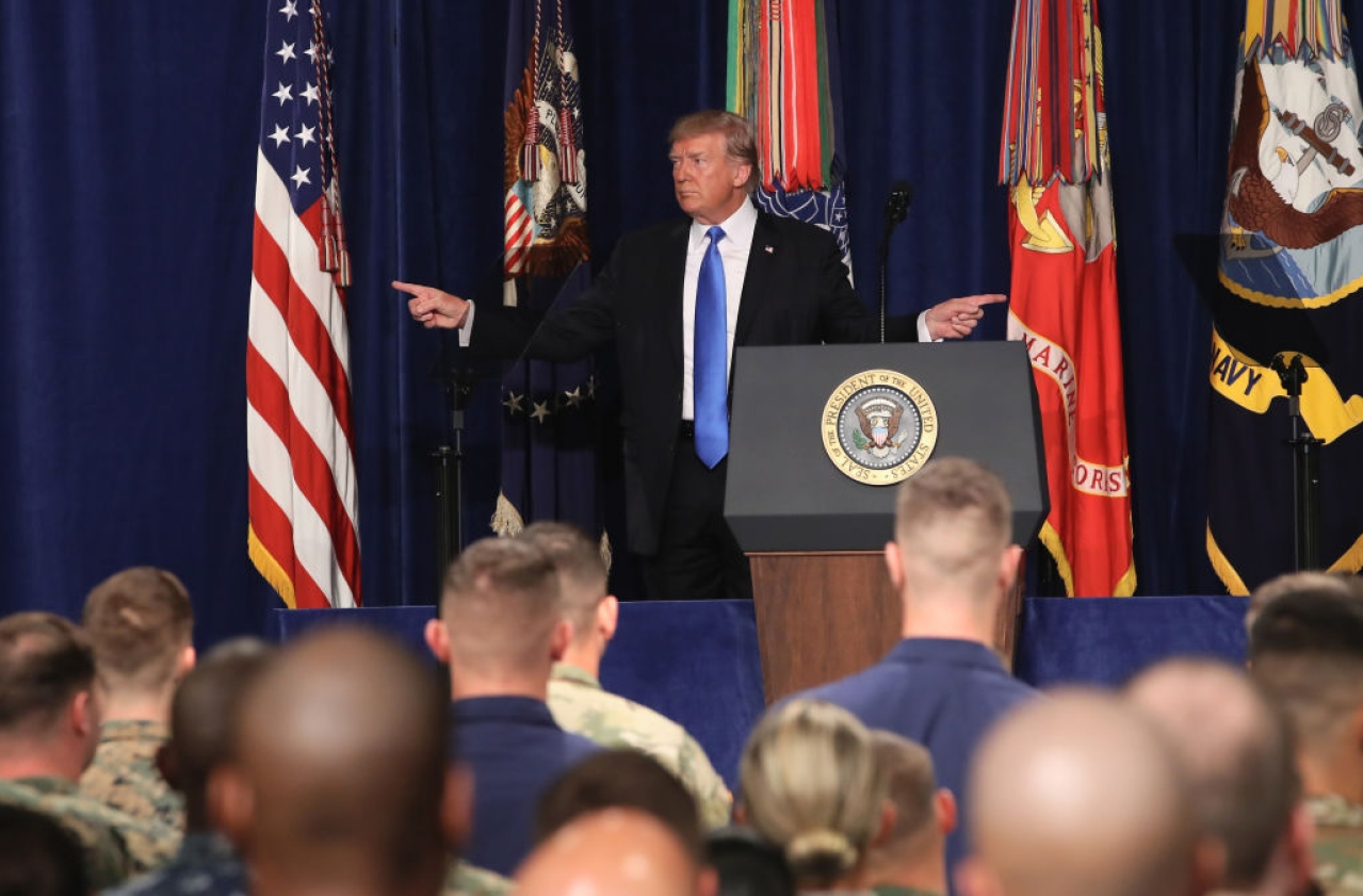 US President Donald Trump gestures before delivering remarks on America's military involvement in Afghanistan at the Fort Myer military base on 21 August  2017 in Arlington, Virginia. (Mark Wilson/GettyImages)