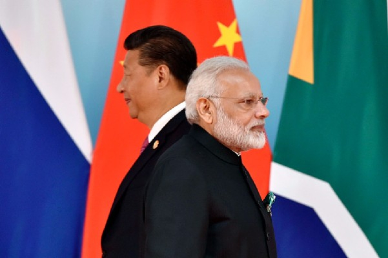 Chinese President Xi Jinping (L) and Prime Minister Narendra Modi at the group photo session during the BRICS Summit in China. (KENZABURO FUKUHARA/AFP/Getty Images)