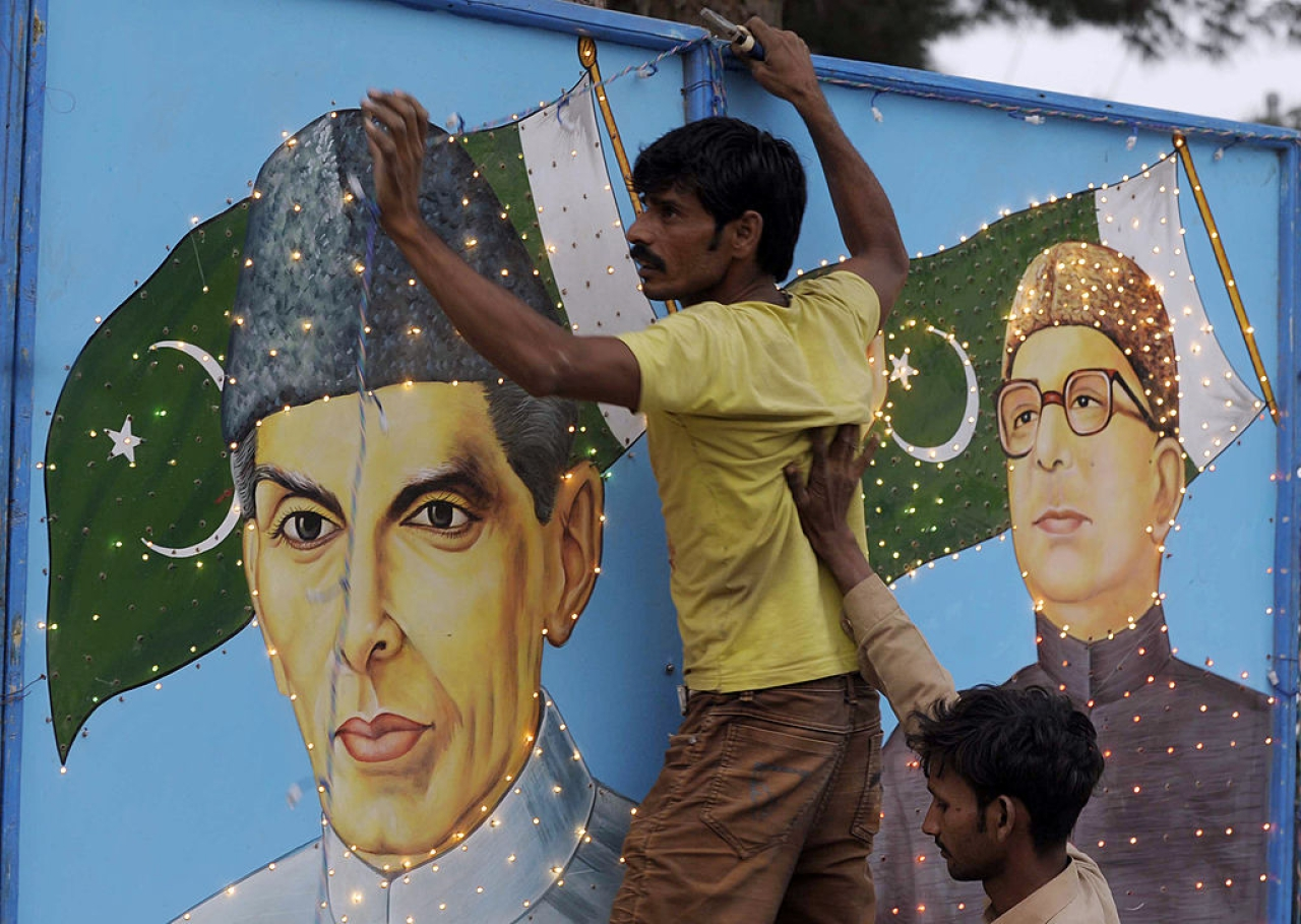 A Pakistani man decorates with a portrait country's founder, Mohammad Ali Jinnah, ahead of the country's Independence Day in Quetta. (BANARAS KHAN/AFP/Getty Images)