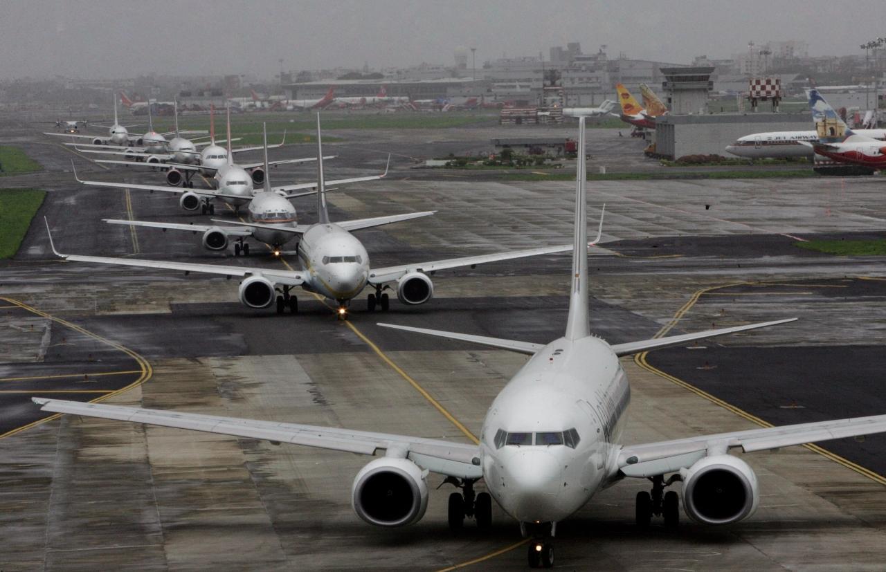 Planes lined up for take-off at Mumbai Airport (Vijayananda Gupta/Hindustan Times via Getty Images)