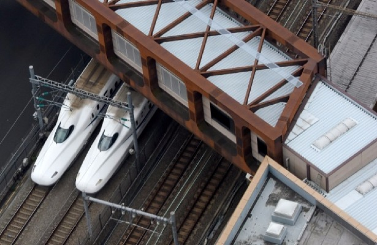 A pair of Shinkansen trains are seen under a pedestrian overbridge in Tokyo. (TORU YAMANAKA/AFP/Getty Images)
