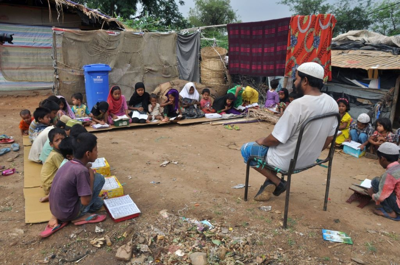 Rohingya Muslim refugee children from Myanmar study at a makeshift madrasa (religious school) on World Refugee Day in the outskirts of the Indian city Jammu on June 20, 2017. Hundreds of thousands of Muslim Rohingya have fled from Myanmar in recent decades, escaping persecution from the Buddhist-majority nation for generations. (AFP/Getty Images)