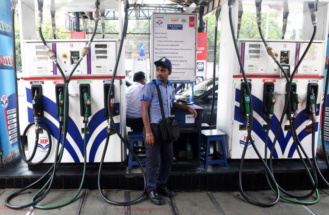 An Indian petrol pump attendant waits for customers at a gas station in Kolkata on June 16, 2017. (DIBYANGSHU SARKAR/AFP/Getty Images)