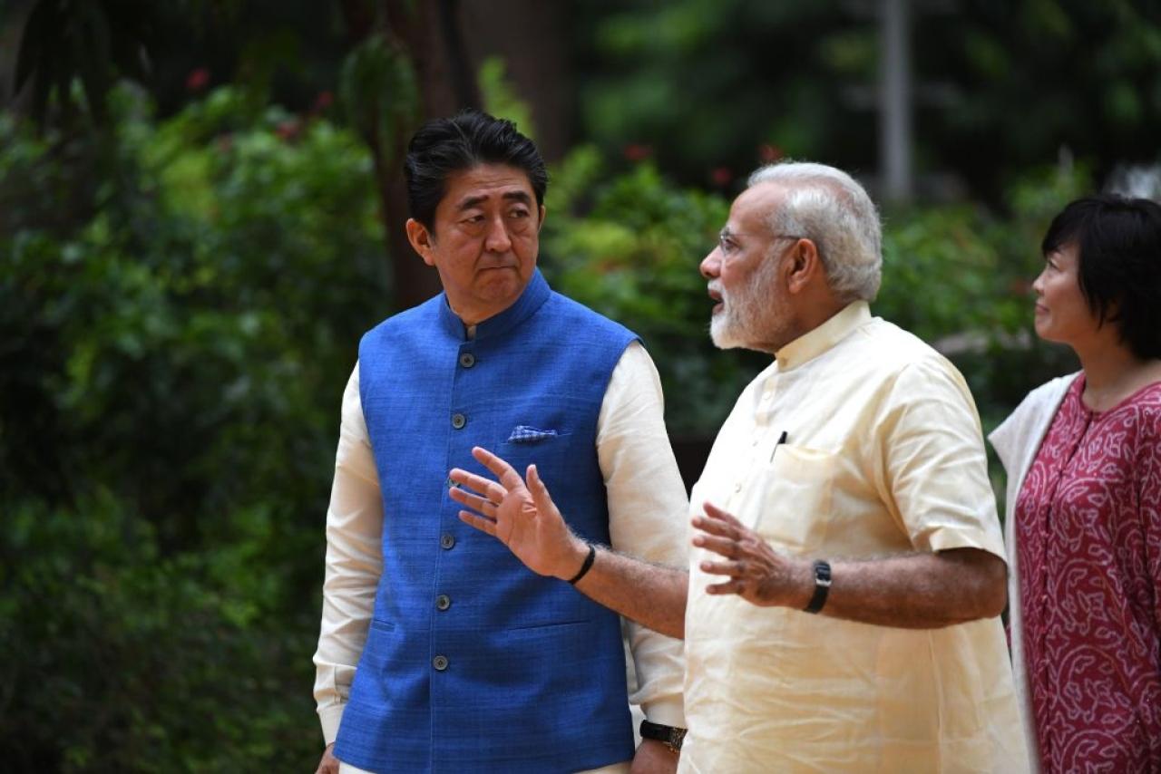 Japanese Prime Minister Shinzo Abe (L) with Prime Minister Narendra Modi (C) in Ahmedabad on 13 September 2017. (PRAKASH SINGH/AFP/GettyImages)