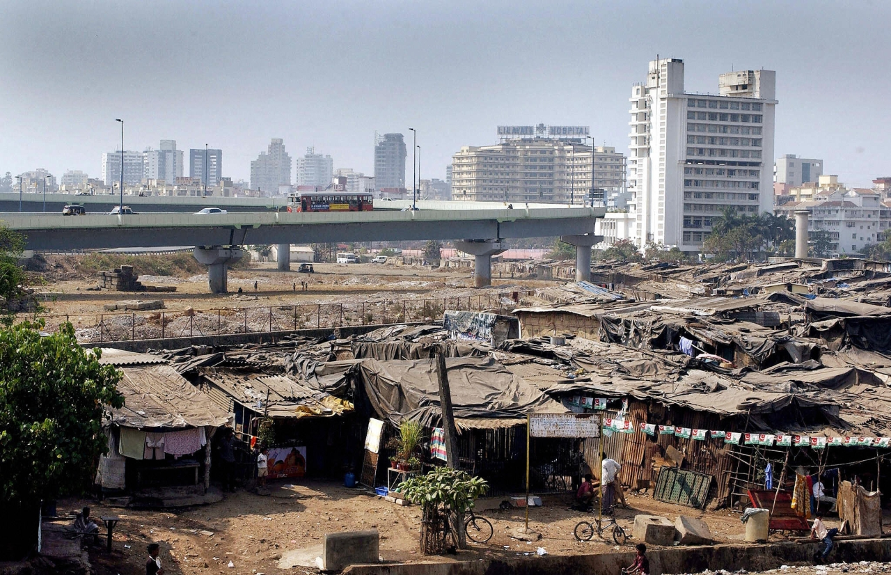 Residents go about their business in a colony of slum dwellings surrounding a newly-built flyover and high-rise apartments in the Bandra suburb of Mumbai. (SEBASTIAN D'SOUZA/AFP/GettyImages)
