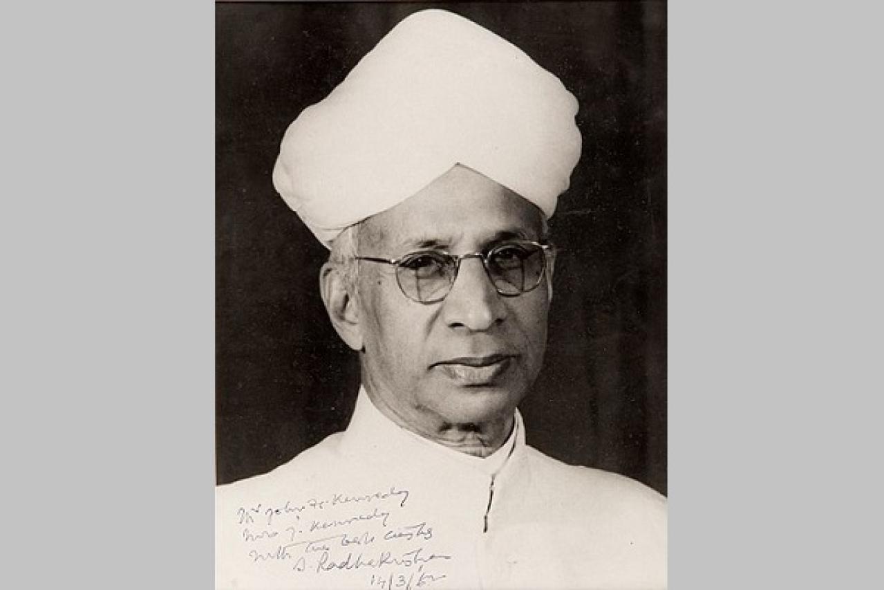 A black-and-white portrait photograph of the Dr Sarvepalli Radhakrishnan, inscribed to President John F Kennedy.