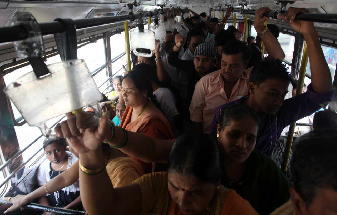 Women wade through a crowded bus (Anshuman Poyrekar/Hindustan Times via Getty Images)