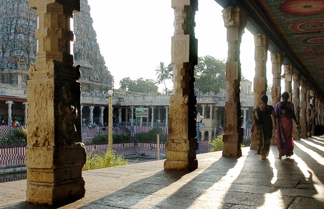 Devotees walk through a collonade at the Meenakshi Temple in Madurai (DIBYANGSHU SARKAR/AFP/Getty Images)