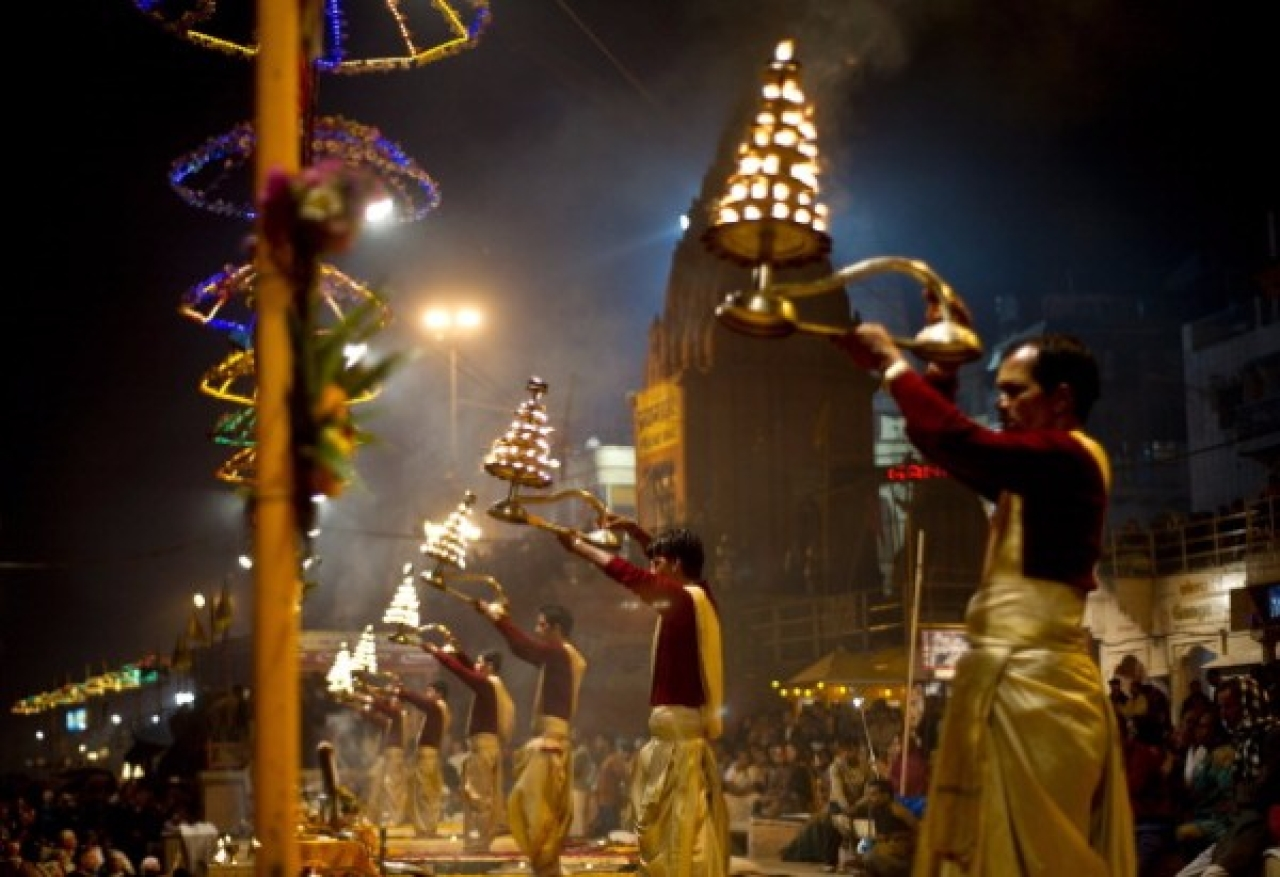 Hindu priests offer evening prayers on the banks of the River Ganges in Varanasi. (MANAN VATSYAYANA/AFP/Getty Images)