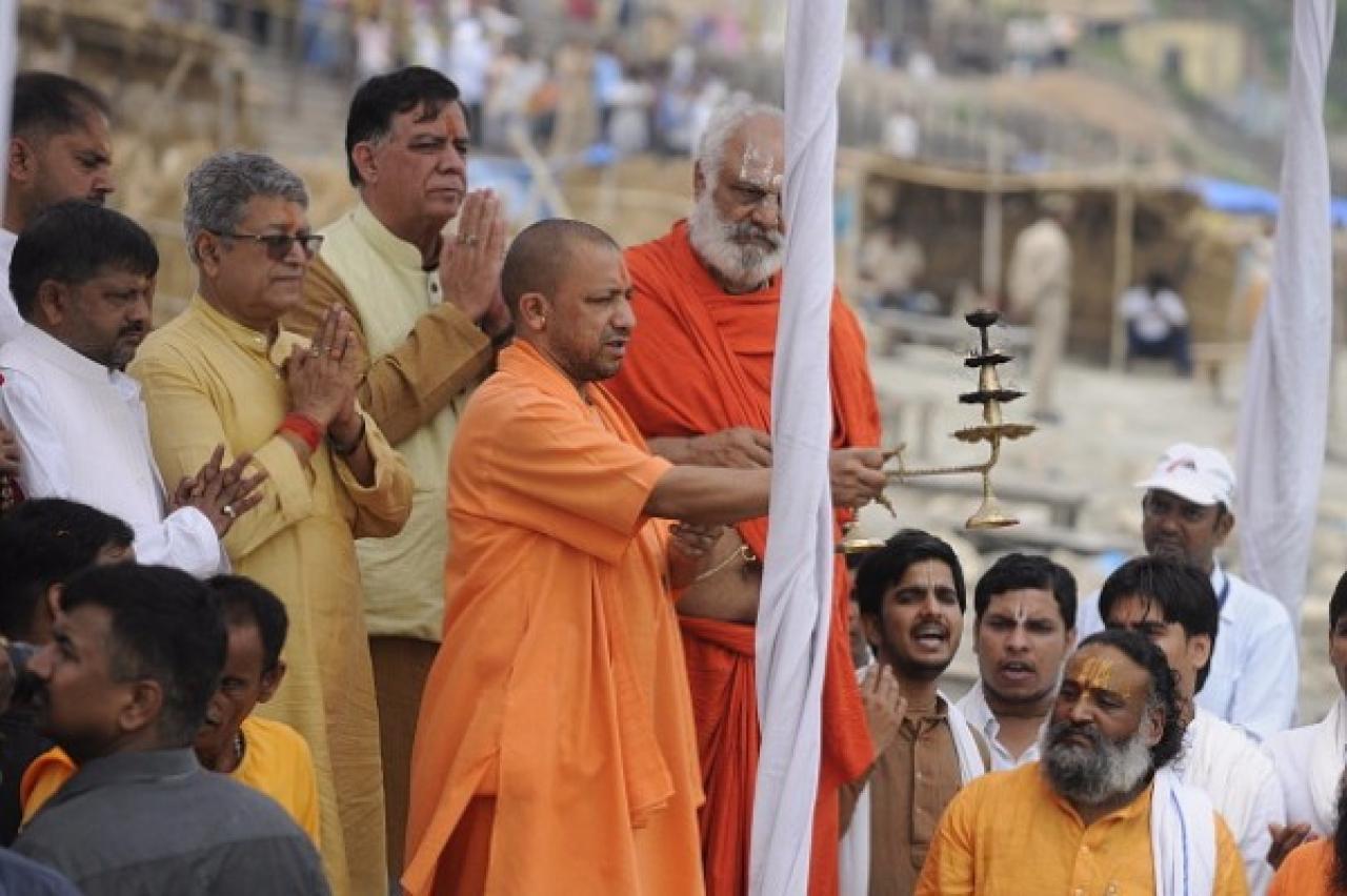 Uttar Pradesh Chief Minister Yogi Adityanath doing arti at Sarayu River ghat in Ayodhya. (Deepak Gupta/Hindustan Times via Getty Images)