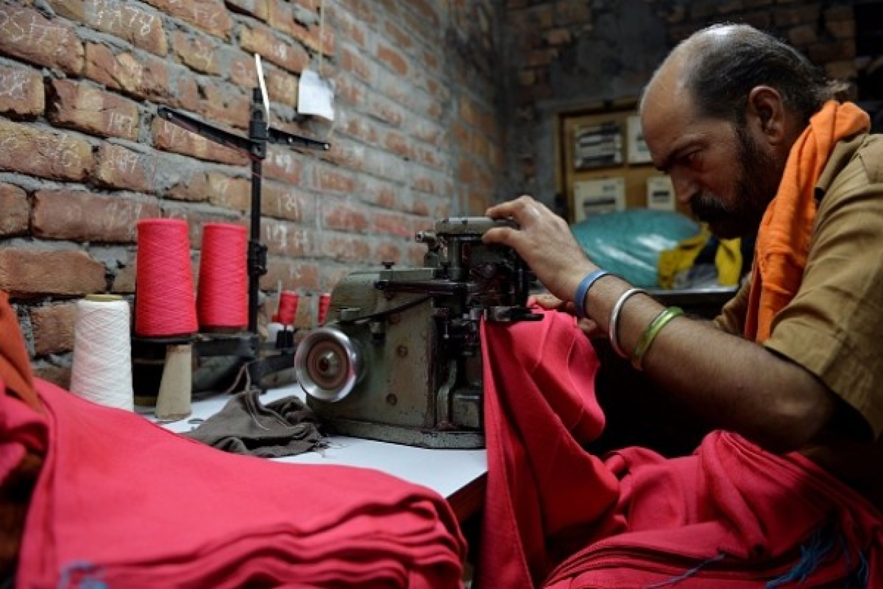 An Indian man works on a machine at a garment factory in Ludhiana. (MONEY SHARMA/AFP/Getty Images)