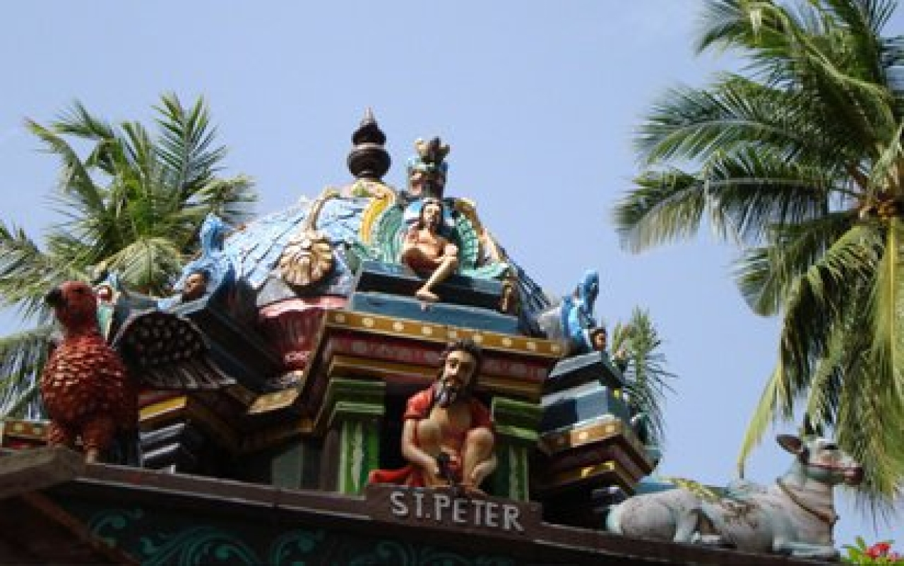Jesus depicted as Dakshinamurthi, with Peter at his feet dressed like a Hindu sadhu: Shantivanam