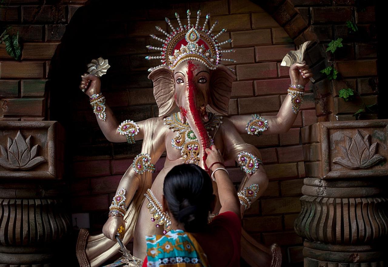 A Bangladeshi Hindu devotee worships Lord Ganesh in Dhaka, Bangladesh. (Allison Joyce/GettyImages)