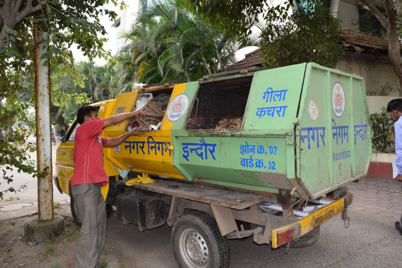 Municipal waste collection truck on one if its early morning drives.