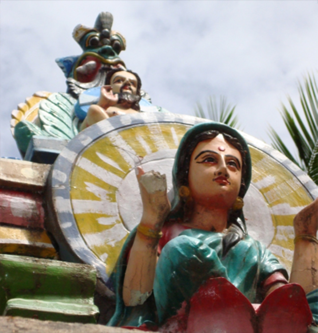 Image of Mary seated at the feet of Christian male deity: yet confused with Mariamman –the goddess.