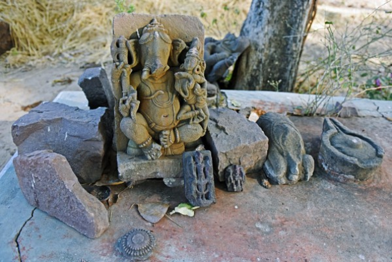 Statue of Lord Ganesha among the relics strewn within the wall found in the jungle of Raisen.