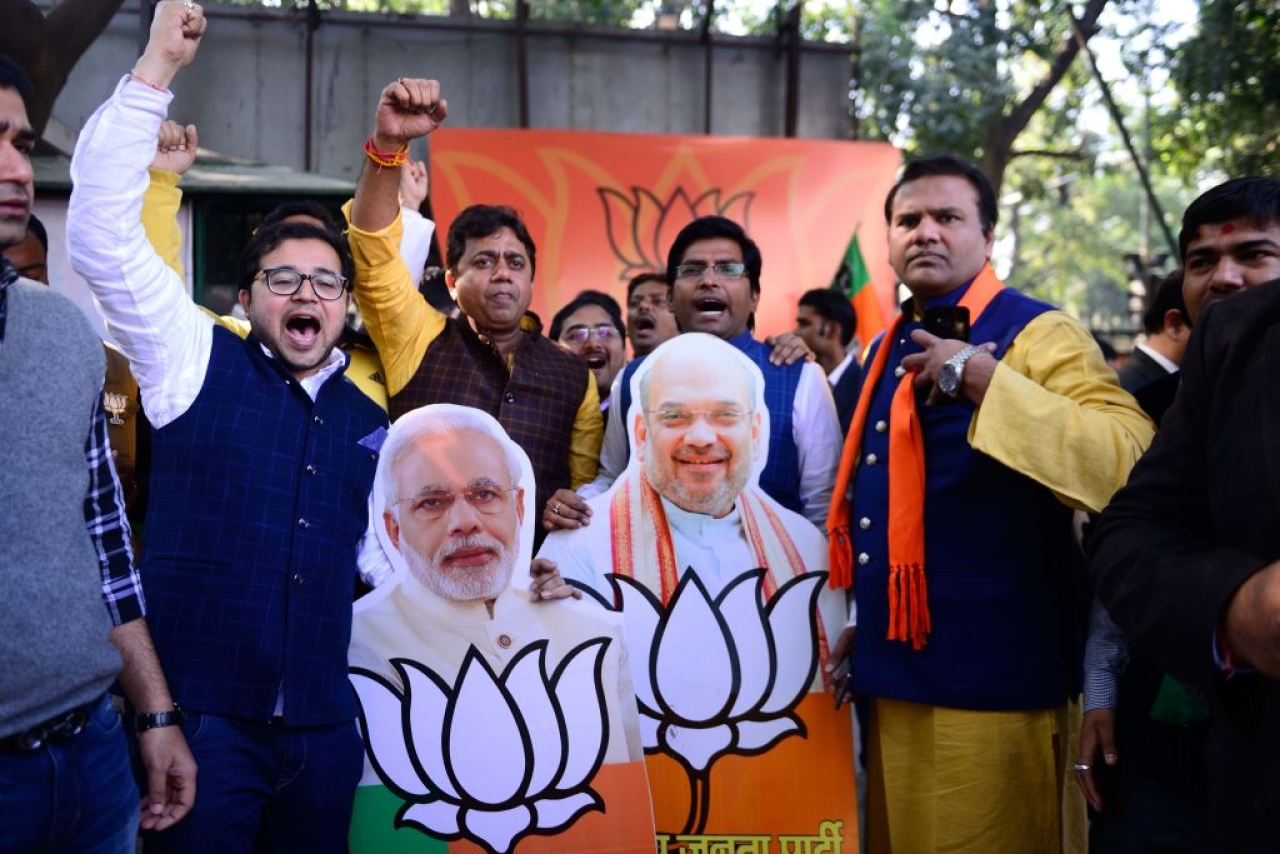 BJP supporters celebrate outside BJP office after victories in Gujarat and Himachal Pradesh elections on 18 December in New Delhi, India. (Pradeep Gaur/Mint via GettyImages)