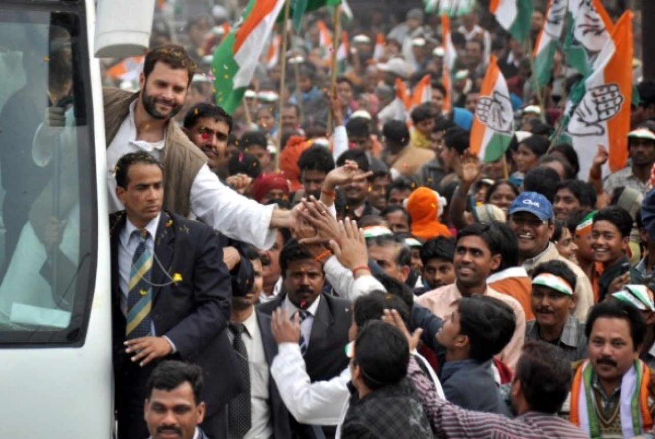 Congress president Rahul Gandhi shaking hands with people during a road show in Lucknow, in 2012, when he was the party's general secretary. (Ashok Dutta/ Hindustan Times via Getty Images)