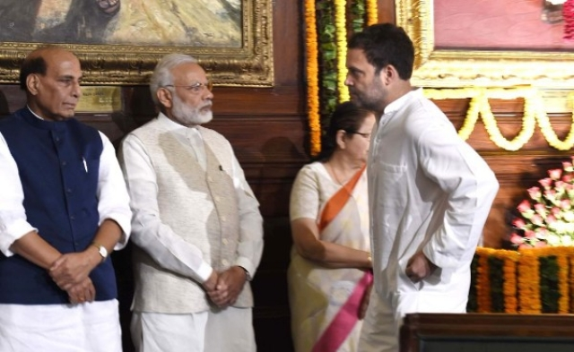 Prime Minister Narendra Modi and Congress vice-president Rahul Gandhi during a floral tribute ceremony on the portrait of Sardar Vallabhbhai Patel on his birth anniversary at Parliament House on 31 October  2017 in New Delhi.  (Arvind Yadav/Hindustan Times via Getty Images)