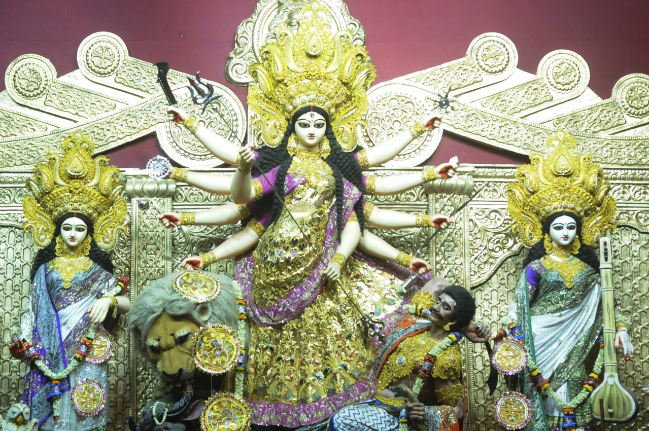 Durga Puja celebrations at Santosh Mitra Square in Kolkata, where the pandal theme is based on the Buckingham Palace of London. (Photo by Samir Jana/Hindustan Times via GettyImages)