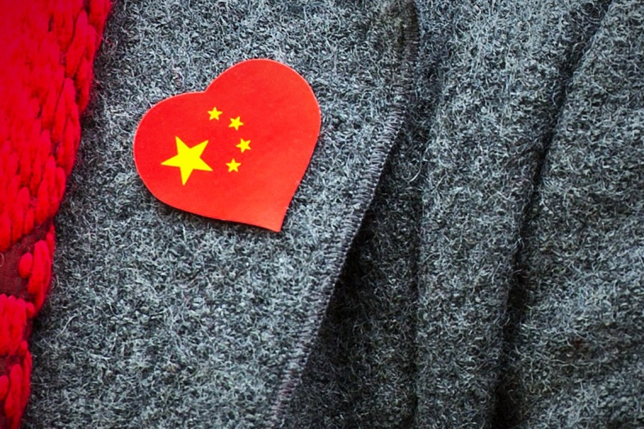A pro-China supporter wears a sticker with the country's flag on, during a counter protest held near Amnesty International, protesting against claims of a deterioration in human rights and censorship of the internet and media during a state visit by Chinese President Xi Jinping to London. (Ben Pruchnie/GettyImages)