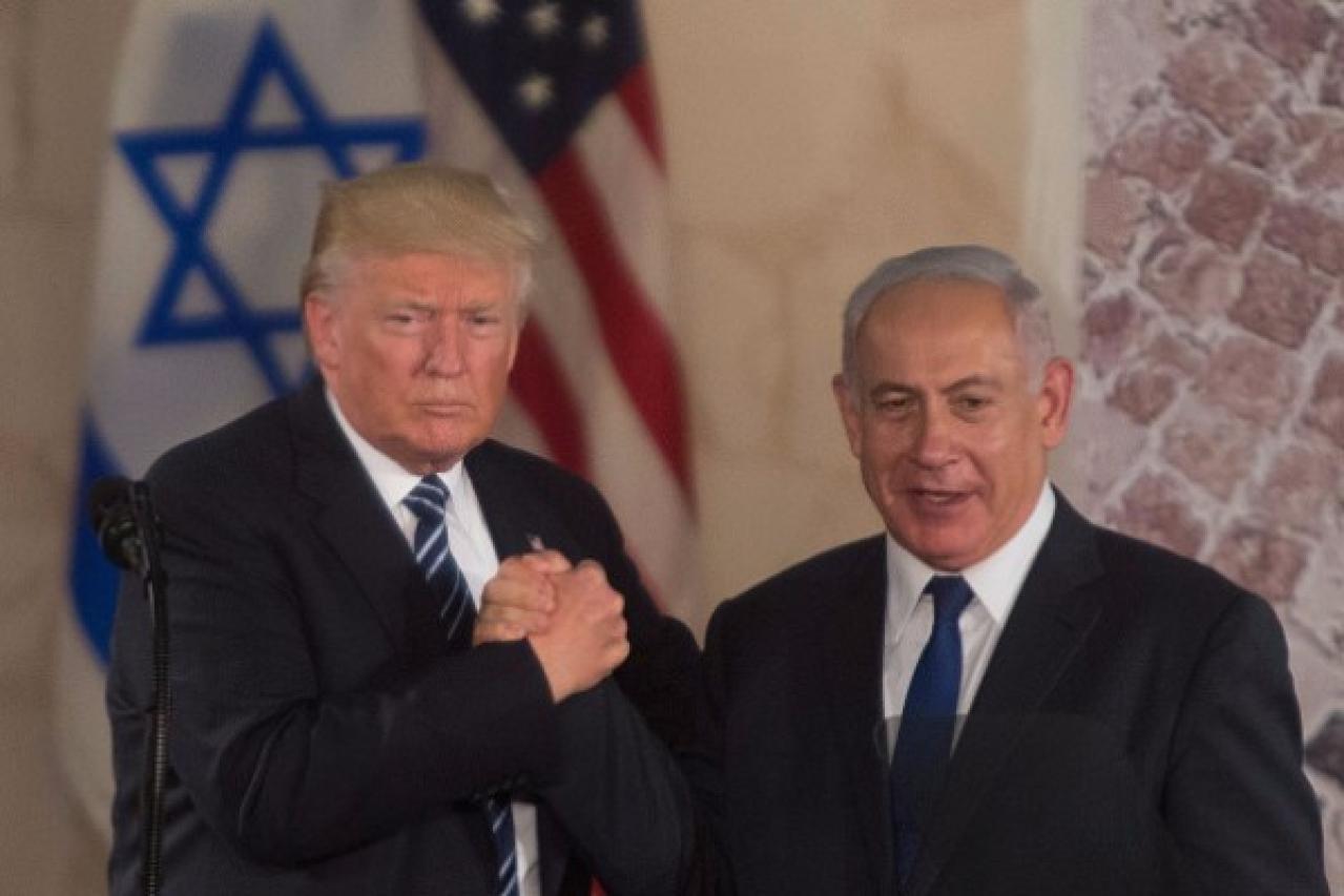 US President Donald Trump, left, and Israel's Prime Minister Benjamin Netanyahu shake hands at the Israel Museum in Jerusalem. (Lior Mizrahi/Getty Images)