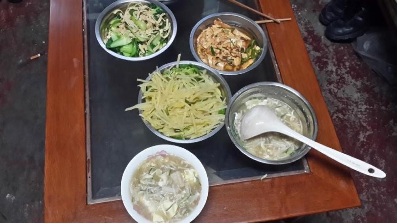 Freshly prepared dishes by <i>ayi</i>.